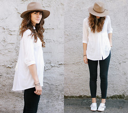 Tonya S. - Urban Outfitters Panama Hat, Asymmetrical Top, Madewell High Riser Jeans - Concrete