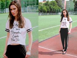 Maria Magdalena Bura - Solo Femme Black Heels, Black Pants, Reserved Graphic Crop Tee - All The Football Cities