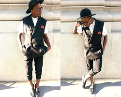 Ronald Gravesande - H&M White Collarless Dress Shirt, H&M Black Double Breasted Blazer Vest, Asos Orange Polka Dotted Pocket Square, Zara Black Silk Pants, Aldo Black Mohair And Leather Shoes, Urban Outfitters Black Hat - What Does Orange Say?