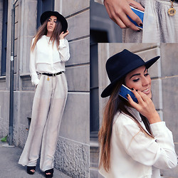 Alison Liaudat - Zara Pants, Urban Outfitters Hat, Savelli Genève Ultra Luxe Mobile Phone, Saint Laurent Vintage Belt - We are all connected