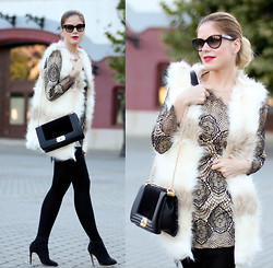 Laura Maxim -  - Lace and fur for a cold day