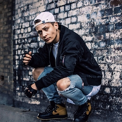 Mago Dovjenko - Cheap Monday Ripped Jeans, Nike Sneakerboot Lunarforce, Nid De Guapes Bomber Jacket, Naviiv Cap, Adyn Long Shirt, Givenchy Necklace - LONDON