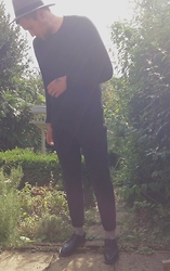 Harry Maddison - H&M Fedora, H&M Jumper, Asos Joggers, Dr. Martens Shoes - Black and Grey