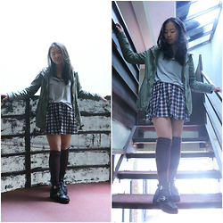 Shirley M - American Eagle Outfitters Gray Henley, Forever 21 Plaid Pleated Skirt, Ardene's Knee High Socks, The Style Club Cut Out Boots, Forever 21 Green Anorak - Take Risks