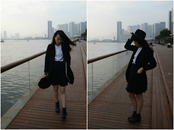 Joyce Tse - H&M Black Hat, Uniqlo White Skirt, Black Coat, Mid Navy Dress, Comme Des Garçons Black Angle Boots - Black & White