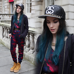 Amber Dennett - Missguided Camo Joggers, Jefffery Campbell Platform Boots, Topshop Bomber Jacket, Missguided Camo Vest, Stüssy Snapback - LFW DAY 1