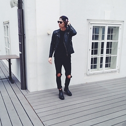 Richy Koll - H&M Chealse Boots, H&M Jeans, H&M T Shirt, Zara Leather Jacket, H&M Glasses, Cap - All black.