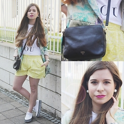 Elaine Hennings - Fossil Crossbody Bag, River Island Pearl Earrings, Sancoo Yellow Shorts, Asos Me And You Shirt, Naf Coloured Coat, Asos Sneakers - Chameleon Spring