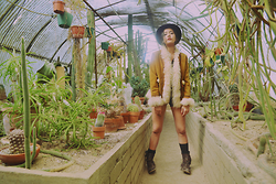 Tatiana M - All Saints Brown Destressed Buckle Boots, Grandma's Closet Vintage Tribal Coat, American Apparel Denim Shorts, Urban Outfitters Wide Brim Hat - Stand Off