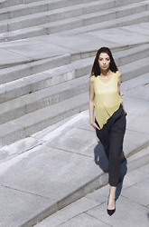 Gabriella Kovari - Lurdes Bergada Yellow Knit Tank Top, Lurdes Bergada Ankle High Creppe Pants Wide Leg, Stradivarius Black Pu Leather Stilletto, Calvin Klein Ck Watch - Minimal urban