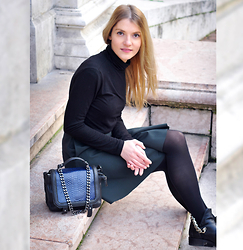 Eugenia Bulah - Massimo Dutti Black Turtleneck, Cos Skirt, H&M Chain Mini Leather Bag, Zara Chain Leather Boots - The wait