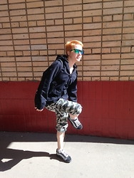 Anastasiia - Spy Optics Ken Block Sunglasses, Fallen Monterey Jacket, New Yorker Camo Pants, Vans Skate Shoes - Ghetto Recon