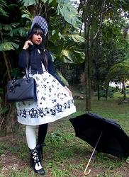 Lais Gonçalves - Le Carrousel Black And White Stripes Bonnet, Body Line White Blouse, Torra Black Cardigan, Loris Black Bag, Body Line Melody Doll, Liberdade Black Sock, Le Café White Sock, Secret Shop Black Boots - Sing for your apathy.