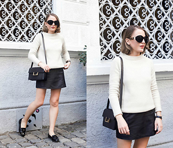 Trini Gonzalez - The Row Sunglasses, Sandro Sweater, Daniel Wellington Watch, T By Alexander Wang Skirt, Saint Laurent Handbag, Miu Loafers - Cream and White