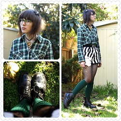 Jennifer Hankin - Thrifted Flannel Shirt With Studded Pockets, Home Made Striped Shorts, Dr Martens Skull - Flannel
