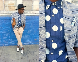 Ronald Gravesande - Asos Blue Denim Polkadot Shirt, Asos Blue And White Striped Blazer, Asos Blue And White Plaid Pocket Square, H&M Tan Carrot Pants With Blue/White Plaid Cuffs, Asos Navy Blue Belt, Urban Outfitters Black Hat, Zara Brown Leather Paper Bag, Asos Black/White Loafers With Tassels - Blue Who?