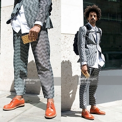 Oli Worlds - Renée Bedell Suit Pants, Renée Bedell Suit Blazer, Acne Studios White Shirt, Senhor Prudêncio Orange Shoes, Vintage 20's Gold Clutch, Madpax Bagpack, Cartier Nail Bracelet - LCM SS16 Day 4