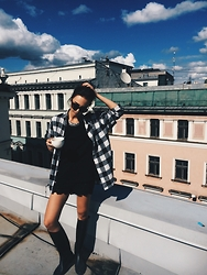 Agnija Grigule - H&M Plaid Shirt, H&M Black T Shirt, Stunner Collective Necklace - FESTIVAL CHIC