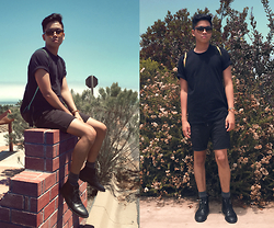 Seb Dang - Urban Outfitters Zipper T Shirts, Urban Outfitters Shorts, Aldo Leather Boots, Adidas Gym Bag - It's all about black.