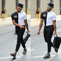 Askia Abdull - Forever 21 Top Hat, Urban Outfitters Eyewear, Topman Bag, H&M Pants, Dr. Martens Sandals, Joycelyn Tamaris Hill Contrast Viii/Iixiixi T Shirt - #Nyfwm day 1 Contrast