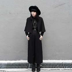 Michelle K - Asos Ornamental Cross Necklace, Ivory Jar Christ Necklace, Asos Faux Leather Embossed Wide Belt, Asos Black Culottes, Puzzle Zipper Boots, Black Cape Shirt, Asos Studded Wide Brim Hat - The Wretched