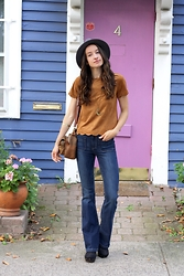 Lindsay W. - Pilcro Superscript Flares, Madewell Leather And Calf Hair Purse, Free People Moon Pendant, Vince Camuto Wool Hat - 70s Vibes