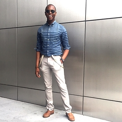 "David Thande - Sperry Topsider A/O Penny Loafers, Zara Slim Chinos, Apple Stainless Steel Space Black Watch, Etsy Tiger Eye Bracelet, Jcrew Chambray Striped - "" I owe it to that generation."""