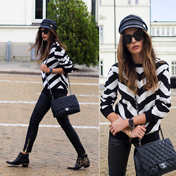 Katia Peneva - Balmain X H&M Men Sweater, Balmain X H&M Biker Leather Pants, Chanel Bag, Gucci Hat, Céline Sunglasses, Apple Watch - Balmain x H&M Look 2