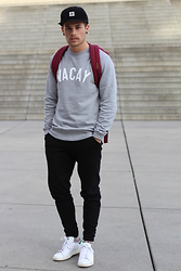 Kevin Elezaj - Adidas Sneakers, Asos Sweatpants, Manners Apparel Sweater, Herschel Bag, Obey Cap - Vacay