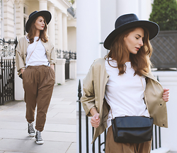 Denisia A. - Moschino White T Shirt, H&M Wool Hat, Reiss Golden Jacket, Cos High Waisted Trousers, Converse Sneakers, H&M Chain Bag - Off duty style