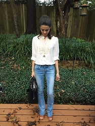 Katie V. - American Eagle Outfitters Bootcut Jeans, Calvin Klein Mules, Tory Burch Bag - 70s Vibe