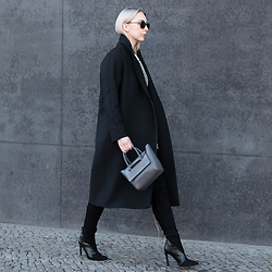 Leonie // www.noanoir.com - Ace & Tate Black Round Sunglasses, Cos Long Black Coat, Eleven Grey Mini Bag, Whistles Monochromatic Knitted Fringed Top, Weekday Black High Waisted Denim Jeans, Zara Leather Heeled Ankle Boots - Weekend Whistles