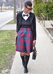 Sushanna M. - Newchic Men's Black Bowtie, Double Breasted Black Coat, Black V Neck Cardigan, Thrifted Vintage Red Green Tartan Culottes, Black Satchel, Thrifted Vintage Men's Black Wingtip Tassel Loafers - Prep School