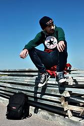 Mohamed Samaras - Champion Beanie, Converse Hoodie, H&M Jeans, Carhartt Plaid Flannel Shirt, Converse Sneakers, Eastpak Backpack - Converse All Star