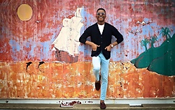 Igee Okafor - Warby Parker Sunglasses, Uniqlo Cardigan, H&M Chinos, Jack Erwin Penny Loafers, Shore Projects Wrist Watch - Injecting Color To Your Casual Look