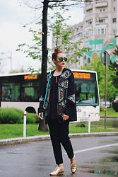 Andreea Birsan - Polaroid Green Sunglasses, H&M Embellished Jacket, C&A Black Bell Sleeve Blouse, Mango Black Tailored Trousers, Il Passo Gold Metallic Shoes, Leather Color Block Bag - How to style an embellished jacket