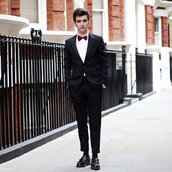 Matthias C. - Black Tuxedo Jacket, Black Dressed Pants, Dr Martens Loafers, Rounded Collar Shirt, Red Bow Tie - The end of UNI