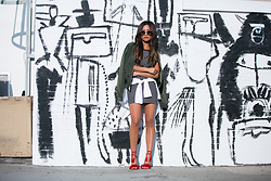 Jessi Malay - Express Olive Bomber Jacket, Express Striped Square Neck T Shirt Dress, Express White Half Rim Sunglasses - Bomber Jacket Ensemble 3