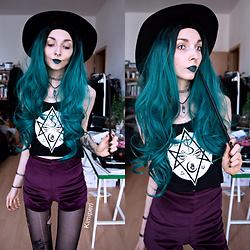 Kimi Peri - Black Hope Curse Mystic Crop Top, Mxci Velvet Plum Shorts, Black Moon Crescent Necklace, Choker, H&M Witchy Hat, Shop Chokers Turquoise Stone Pendant, Black Tights - The Slytherin Witch