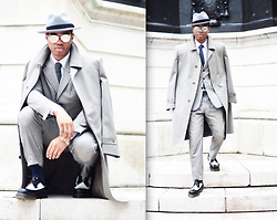 Omiri Thomas - Marks & Spencer Hat, Massimo Dutti Coat, Hardy Amies Tie, T.M.Lewin Shirt, Austin Reed Suit, Dr. Martens Shoes - REFLECTION