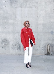 Rekay Style - Ray Ban Round Sunglass, Ader Error Baseball Jumper, Style Nanda White Bootcut Jeans, 3.1 Phillip Lim Laceup Sandal, Balenciaga Canvas Clutch - Longer Sleeve