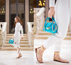Silver Girl - Versace Aqua Blue Handbag, Tintoretto White Jumpsuit, Claire's Golden Leaves Headband, Zara Golden Gladiators - THRONE OF DUBAI