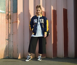 Ellie Fowler - Pop Boutique Cat Eyes, Patta X Mitchell & Ness Bomber, Patta Money Tee, New Look Culottes, Converse Trainers, Lamoda Bagpack - Patta X Mitchell & Ness