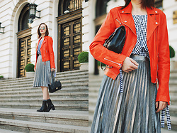 Andreea Birsan - Silver Metallic Skirt, Skirt, Orange Leather Jacket, Gingham Off Shoulder Top, Leather Ankle Boots, Glitter Socks, Leather Crossbody Bag, Mirrored Sunglasses - Orange leather jacket & silver metallic midi skirt