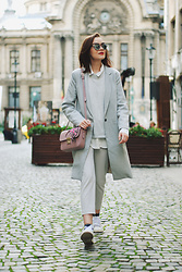 Andreea Birsan - Mirrored Sunglasses, White Button Down, Grey Sweater, Grey Coat, Floral Crossbody Bag, Grey Trousers, Glitter Socks, White Sneakers - Grey coat & floral crossbody bag II