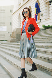 Andreea Birsan - Midi Silver Metallic Skirt, Gingham Off Shoulder Top, Orange Leather Jacket, Black Crossbody Bag, Mirrored Sunglasses, Ankle Boots, Glitter Socks - Orange leather jacket & silver metallic midi skirt II