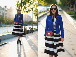 Andreea Birsan - Cat Eye Sunglasses, Scarf, Contrast Top, Blue Leather Jacket, Red Crossbody Bag, Striped Midi Skirt, Leather Ankle Boots - Blue leather jacket & striped midi skirt