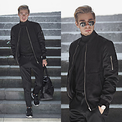 Edgar - Zara Black Cropped Pants, Primark Black Holdall Bag, H&M Black Roll Neck Sweater, H&M Black Bomber Jacket, Nike Black Sneakers, Aeon Black Leather Watch, H&M Black Sunglasses - FROM AM TO PM