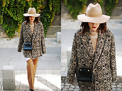 Andreea Birsan - Printed Coat, Beige Hat, Striped Sweater, Mini Crossbody Bag, Camel Wide Leg Pants - How a printed coat can be your secret weapon this fall