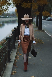 Andreea Birsan - Beige Fedora Hat, Skinny Scarf, Beige Suede Bomber Jacket, White Button Down Shirt, Suede Wrap Skirt, Quilted Leather Crossbody Bag, Suede Ankle Boots, Fishnet Tights - The lady in camel